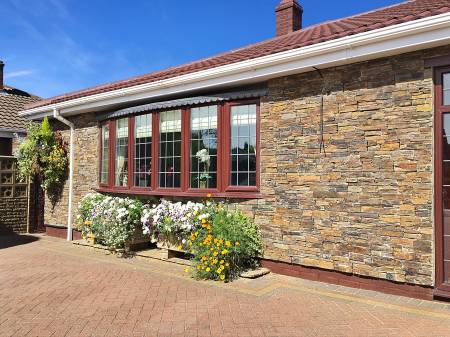 Bungalow stone cladding exterior wall