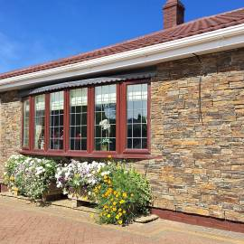 Rustic ZClad stone cladding on bungalow exterior wall